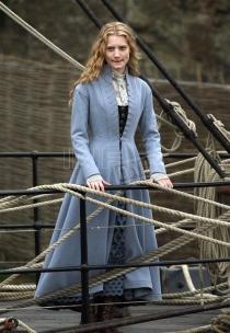 Alice dans le film de Tim Burton partant en Chine pour gagner de l'argent.