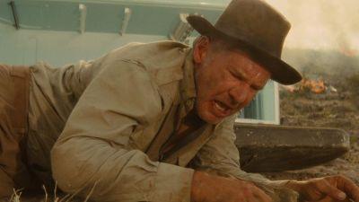 Indiana Jones grimaçant tant ses vieux os le font souffrir.