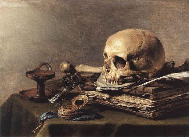 Un exemple de vanitas comprenant un crâne, un ensemble de livre et une bougie éteinte.